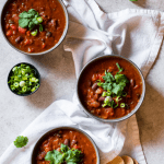three bowls of pumpkin veggie stew