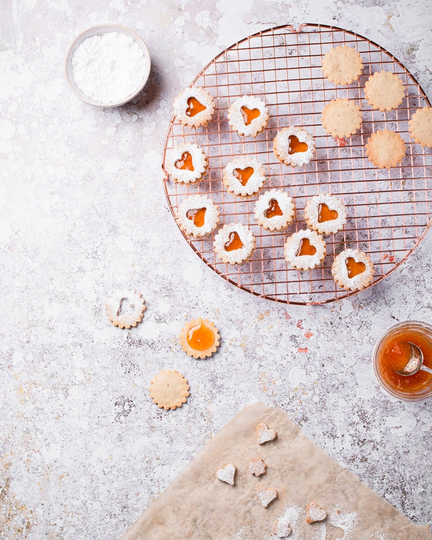 Linzer cookies with apricot preserves and icing sugar