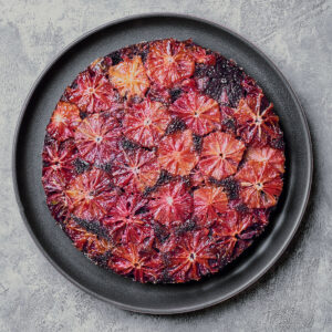 overhead of blood orange cake on a plate