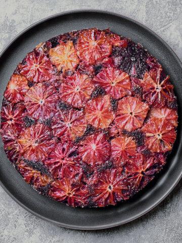 overhead of blood orange cake on a plate