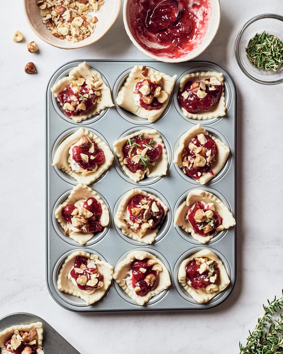 Overhead of mini muffin tin filled with vegan cranberry bites