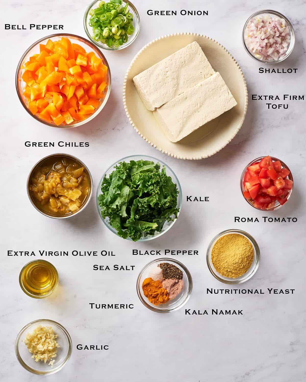 Top down view of ingredients for scrambled tofu
