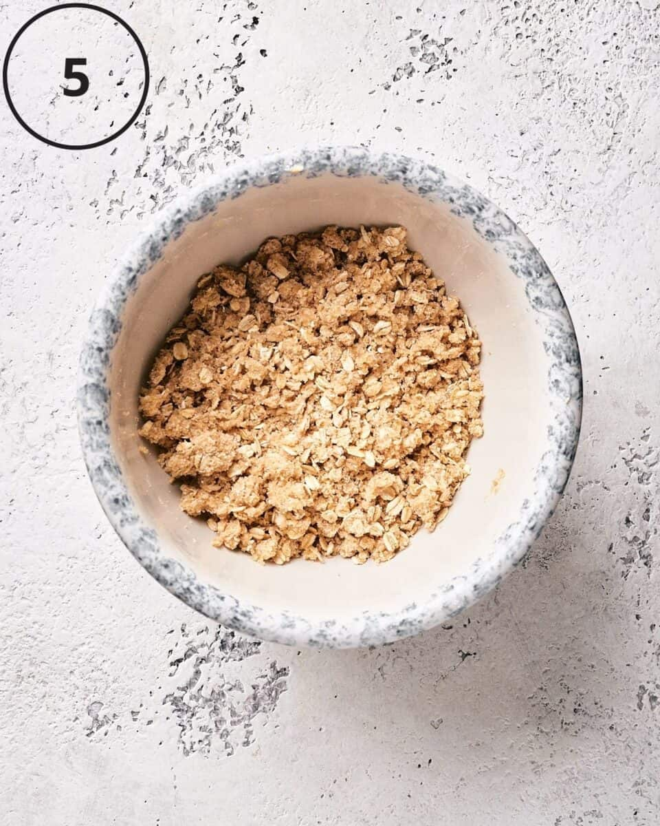 dry ingredients mixed with plant-based butter in bowl in overhead shot