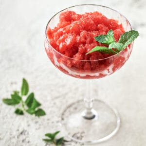 Side view of strawberry lemon gin granita in coupe glass
