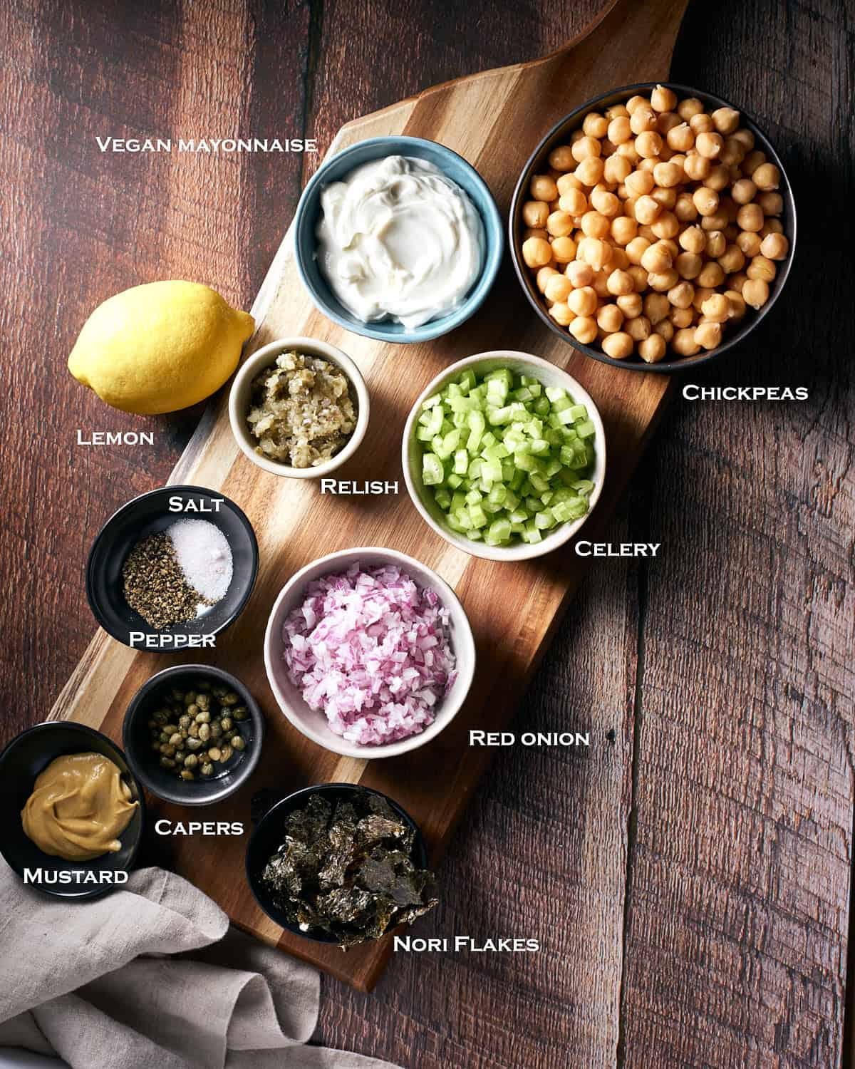 Top view of ingredients in bowls for vegan chickpea tuna salad sandwich