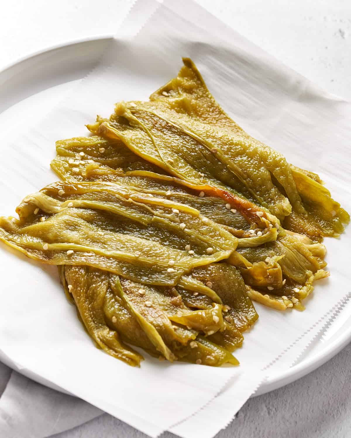 Angle view of Peeled and Roasted Hatch Chiles on parchment paper_Resplendent Kitchen