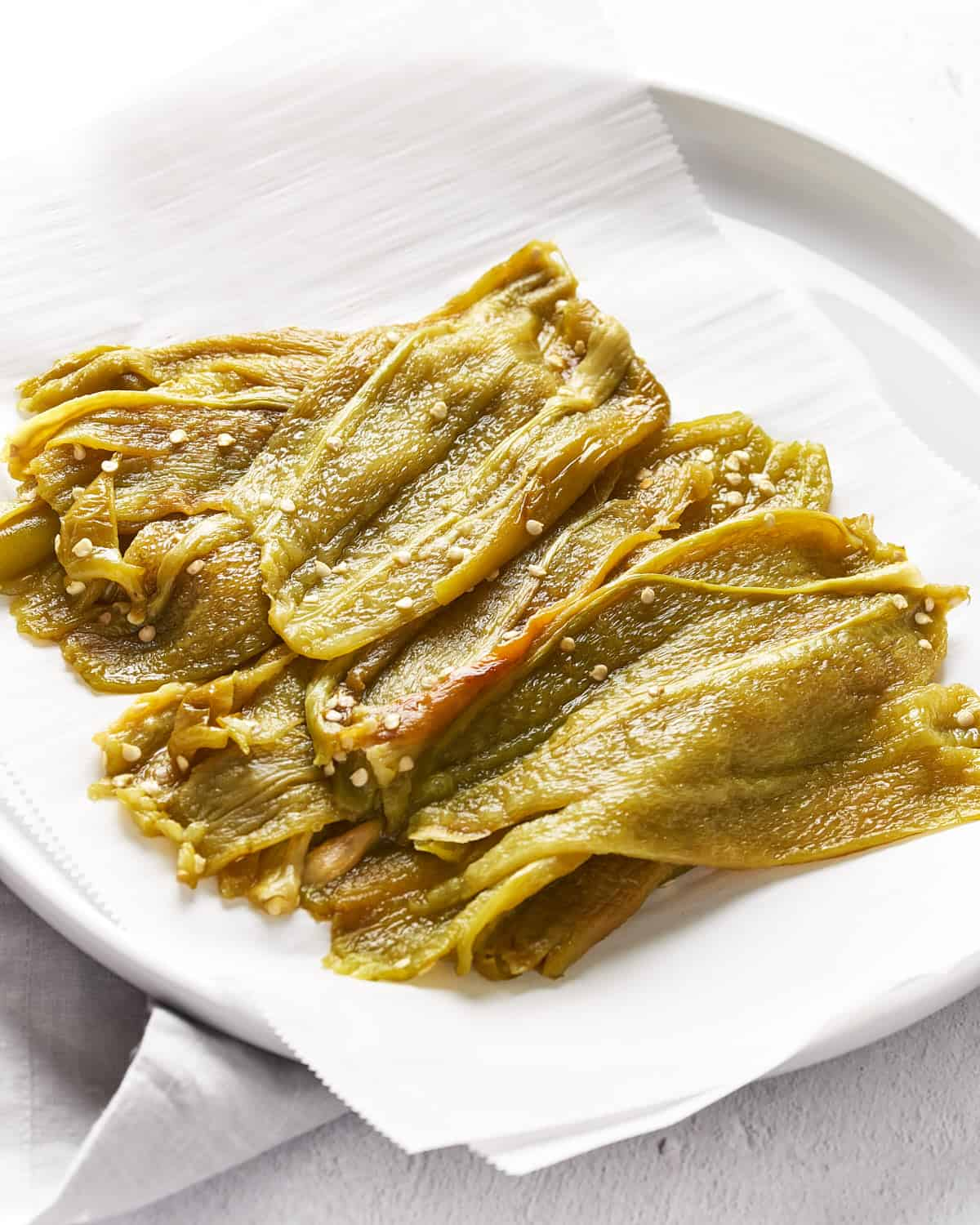 Peeled and seeded New Mexico Hatch chiles on a white plate_Resplendent Kitchen