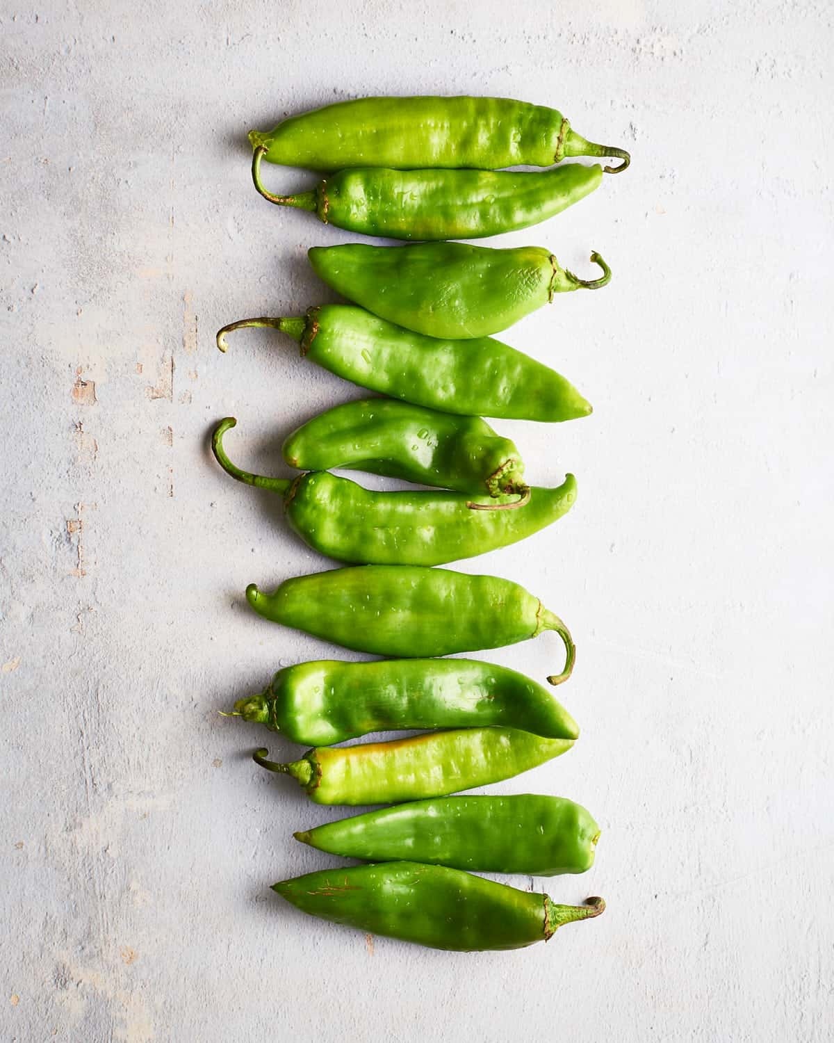 Top down view of Raw Hatch Chiles in a row_Resplendent Kitchen