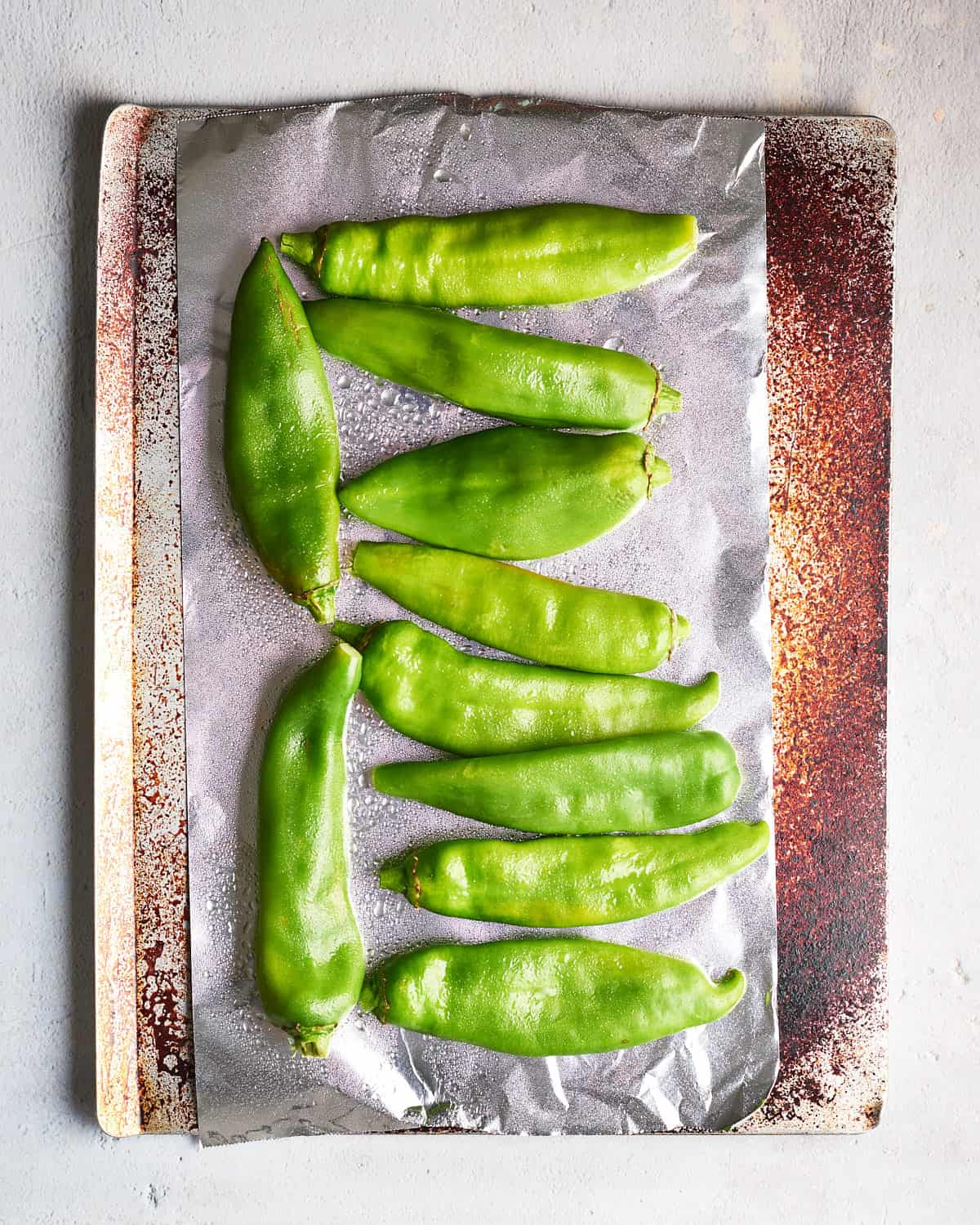 Top down view of Raw Hatch Chiles ready to be roasted on a pan_Resplendent Kitchen
