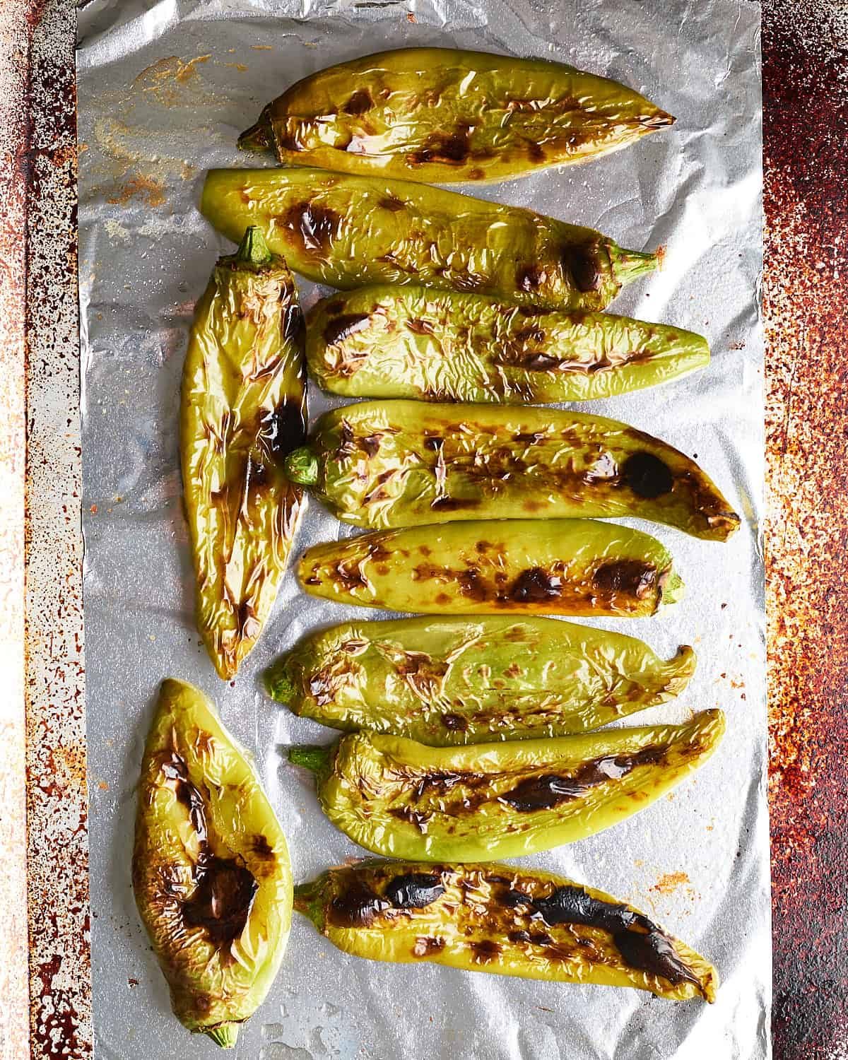 Top down view of Roasted Hatch Chiles on a baking sheet and foil_Resplendent Kitchen